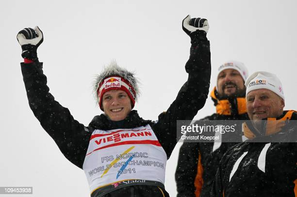 Gold medallist Thomas Morgenstern of Austria celebrates as King Harald V of Norway and Crown Prince Haakon of Norway look on following the Men's Ski...
