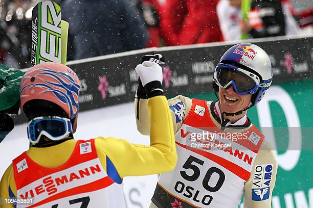 Gold medallist Thomas Morgenstern of Austria celebrates with teammate and silver medallist Andreas Kofler following the Men's Ski Jumping HS106...