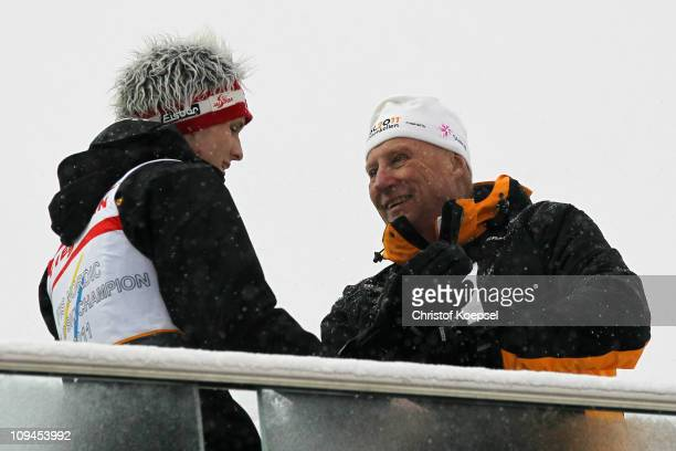 Gold medallist Thomas Morgenstern of Austria speaks with King Harald V of Norway following the Men's Ski Jumping HS106 competition during the FIS...