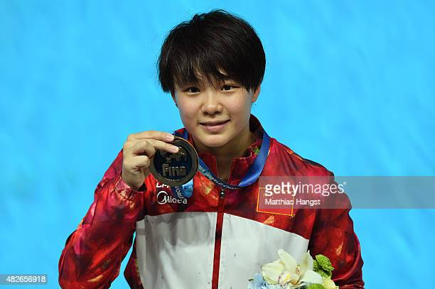 Gold medallist Tingmao Shi of China poses during the medal ceremony for the Women's 3m Springboard Diving Final on day eight of the 16th FINA World...