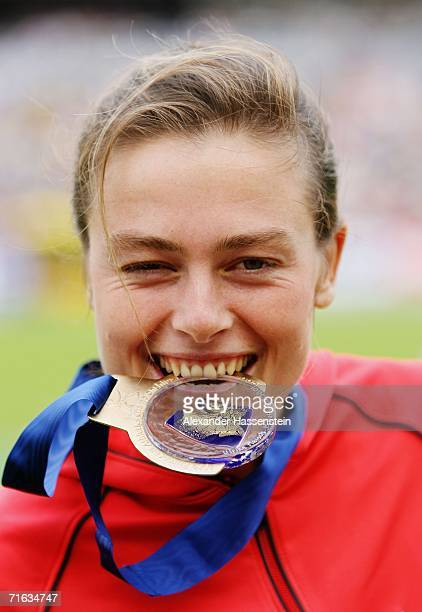 Gold medallist Ulrike Maisch of Germany bites her medal during the medal presentation for the Women's Marathon on day six of the 19th European...