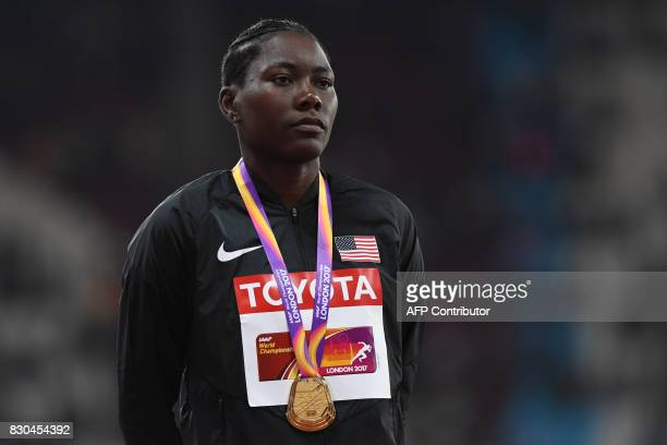 Gold medallist US athlete Brittney Reese poses on the podium during the victory ceremony for the women's long jump athletics event at the 2017 IAAF...