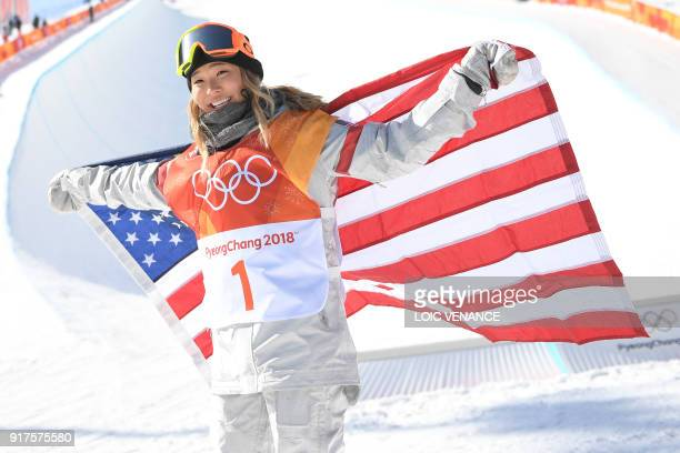 Gold medallist US Chloe Kim celebrates during the victory ceremony after the women's snowboard halfpipe final event at the Phoenix Park during the...