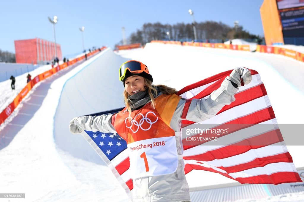 Gold medallist US Chloe Kim celebrates with an US flag during the victory ceremony after the women's snowboard halfpipe final event at the Phoenix Park during the Pyeongchang 2018 Winter Olympic Games on February 13, 2018 in Pyeongchang. /