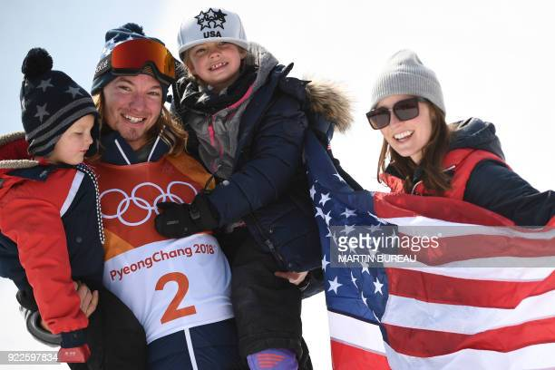 TOPSHOT Gold medallist US David Wise celebrates on the podium with wife Alexandra and children Nayeli and Malachi during the victory ceremony for the...
