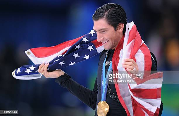 Gold medallist US Evan Lysacek does his honour lap after performing in the Men's Figure skating free program at the Pacific Coliseum in Vancouver...