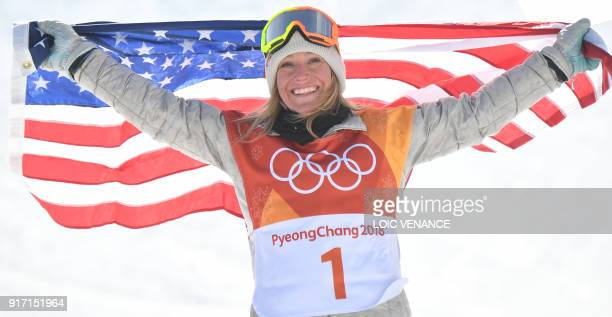 TOPSHOT Gold medallist US Jamie Anderson celebrates during the victory ceremony after the women's snowboard slopestyle final event at the Phoenix...