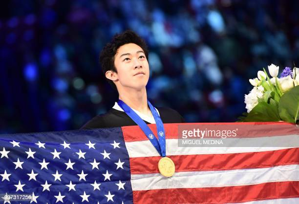 Gold medallist US Nathan Chen poses on the podium of the MenFree Skate program at the Milan World Figure Skating Championship 2018 on March 24 2018 /...