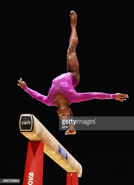 Gold medallist US Simone Biles performs during the Women's balance beam Final at the 2015 World Gymnastics Championship in Glasgow Scotland on...