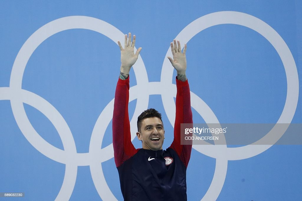 Gold medallist USA's Anthony Ervin celebrates after the Men's 50m Freestyle Final during the swimming event at the Rio 2016 Olympic Games at the Olympic Aquatics Stadium in Rio de Janeiro on August 12, 2016. / AFP / Odd Andersen