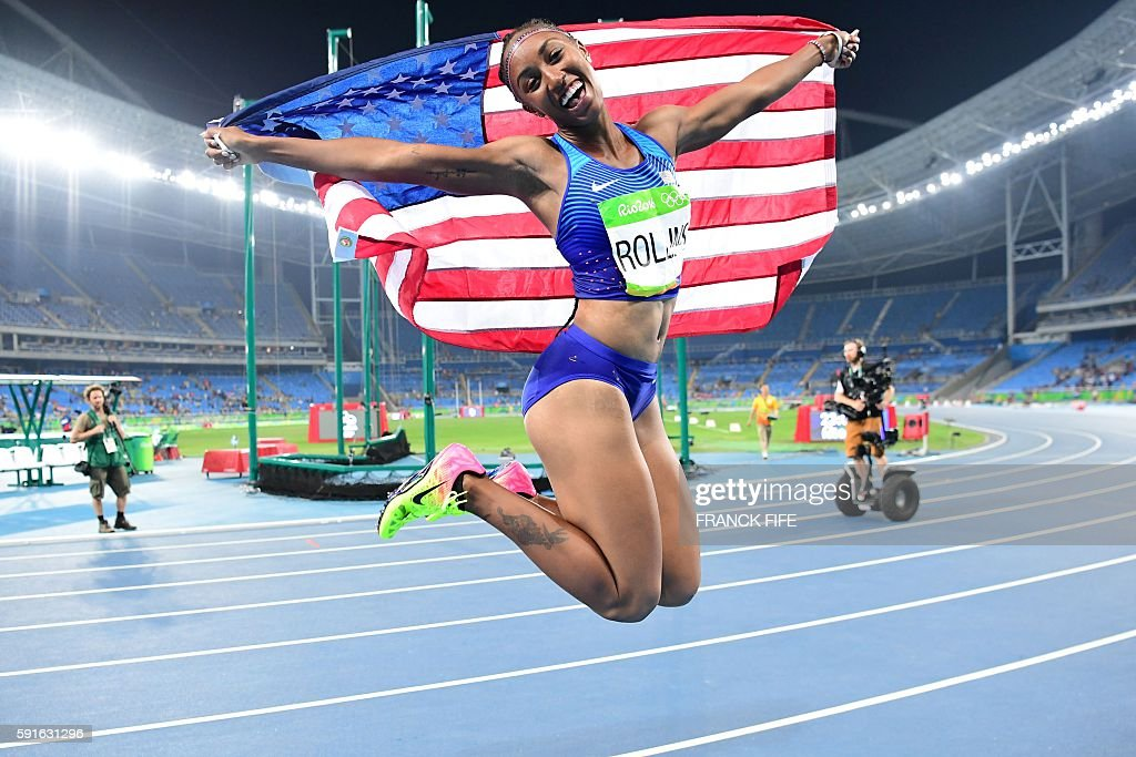 Gold medallist USA's Brianna Rollins celebrates winning the gold medal in the Women's 100m Hurdles Final during the athletics event at the Rio 2016 Olympic Games at the Olympic Stadium in Rio de Janeiro on August 17, 2016. / AFP / FRANCK