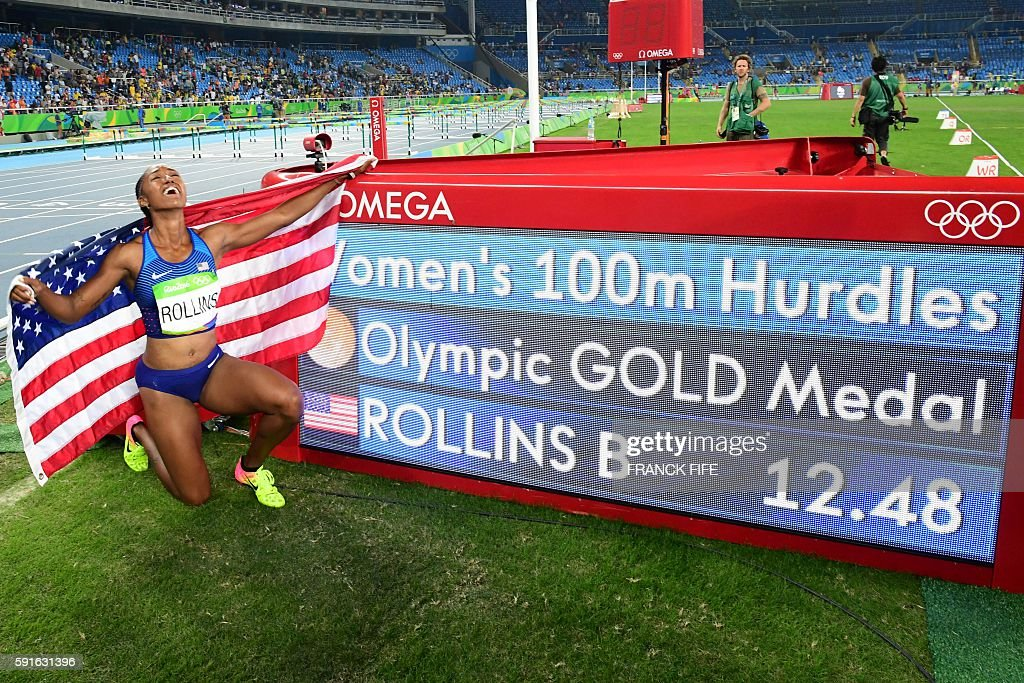 Gold medallist USA's Brianna Rollins celebrates winning the Women's 100m Hurdles Final during the athletics event at the Rio 2016 Olympic Games at the Olympic Stadium in Rio de Janeiro on August 17, 2016. / AFP / FRANCK