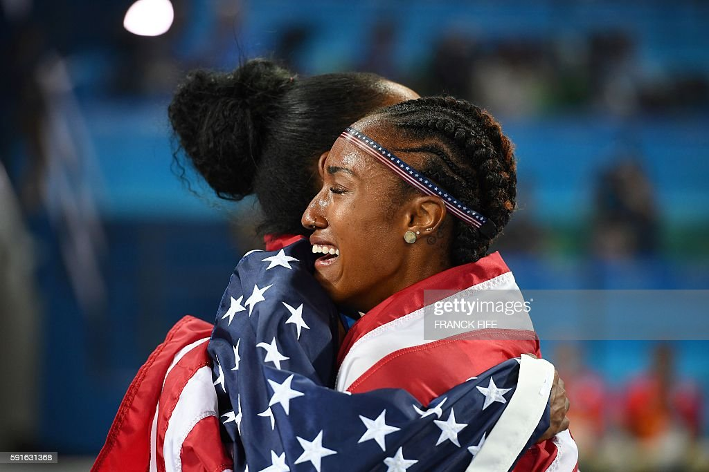 Gold medallist USA's Brianna Rollins (R) celebrates with bronze medallist USA's Kristi Castlin after she won the Women's 100m Hurdles Final during the athletics event at the Rio 2016 Olympic Games at the Olympic Stadium in Rio de Janeiro on August 17, 2016. / AFP / FRANCK