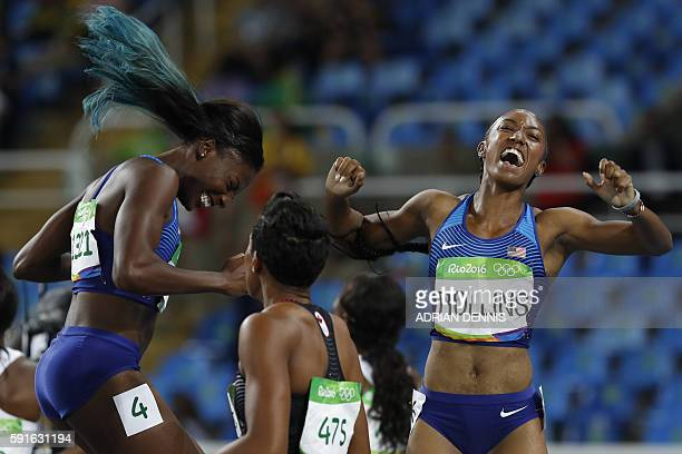 Gold medallist USA's Brianna Rollins celebrates with silver medallist USA's Nia Ali after the Women's 100m Hurdles Final during the athletics event...