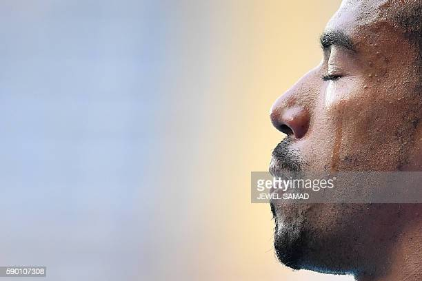 Gold medallist USA's Christian Taylor cries on the podium in the Men's Triple Jump Final during the athletics event at the Rio 2016 Olympic Games at...