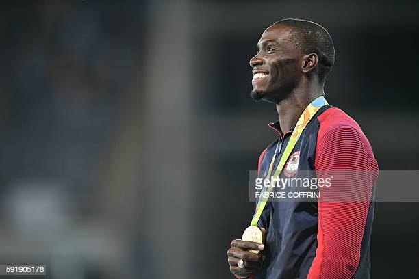 Gold medallist USA's Kerron Clement poses on the podium of the Men's 400m hurdles during the athletics event at the Rio 2016 Olympic Games at the...