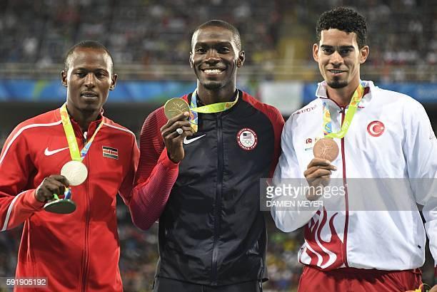 Gold medallist USA's Kerron Clement poses with silver medallist Kenya's Boniface Mucheru Tumuti and bronze medallist Turkey's Yasmani Copello on the...