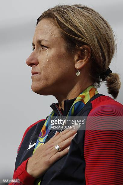 Gold medallist USA's Kristin Armstrong sheds a tear as she listens to the national anthem after the Women's Individual Time Trial event at the Rio...