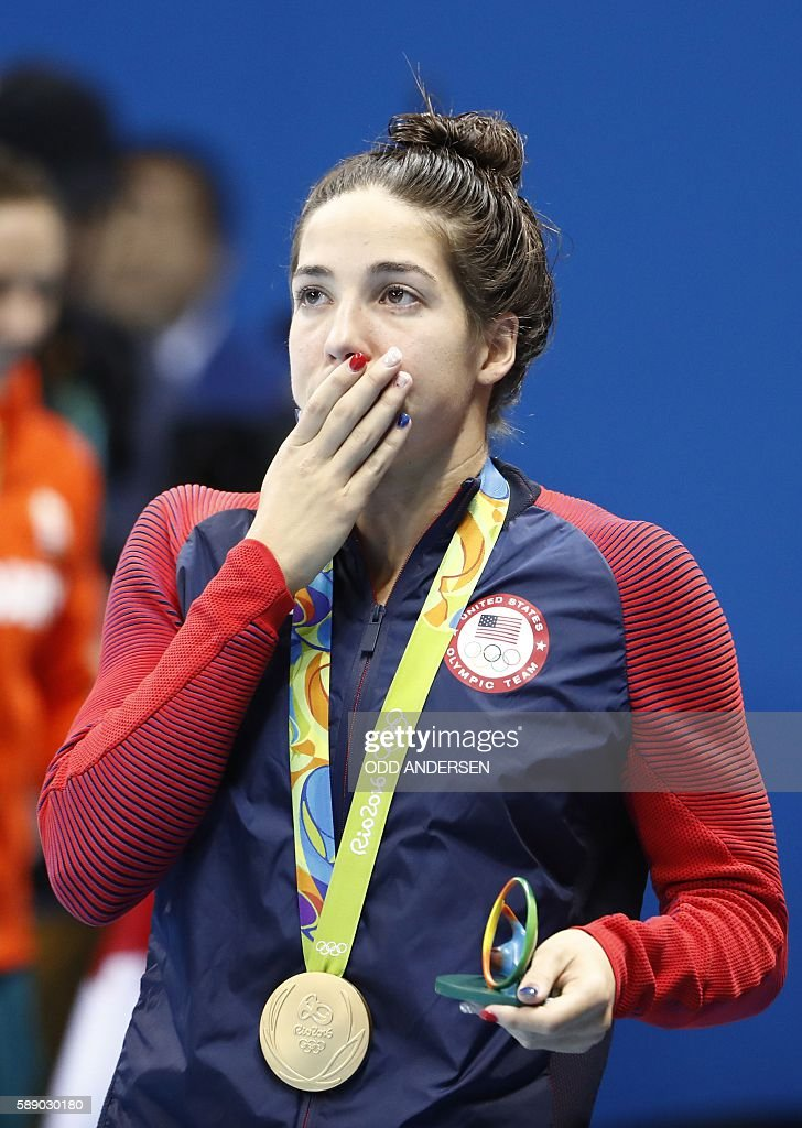 Gold medallist USA's Madeline 'Maya' Dirado reacts during the medal ceremony of the Women's 200m Backstroke Final during the swimming event at the Rio 2016 Olympic Games at the Olympic Aquatics Stadium in Rio de Janeiro on August 12, 2016. / AFP / Odd Andersen