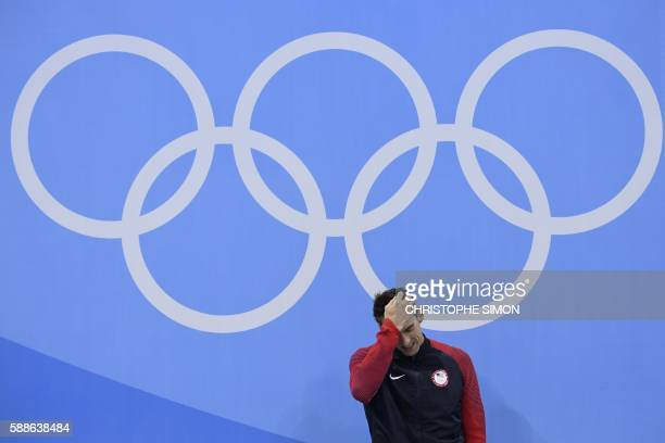 TOPSHOT Gold medallist USA's Michael Phelps poses on the podium of the Men's 200m Individual Medley Final during the swimming event at the Rio 2016...