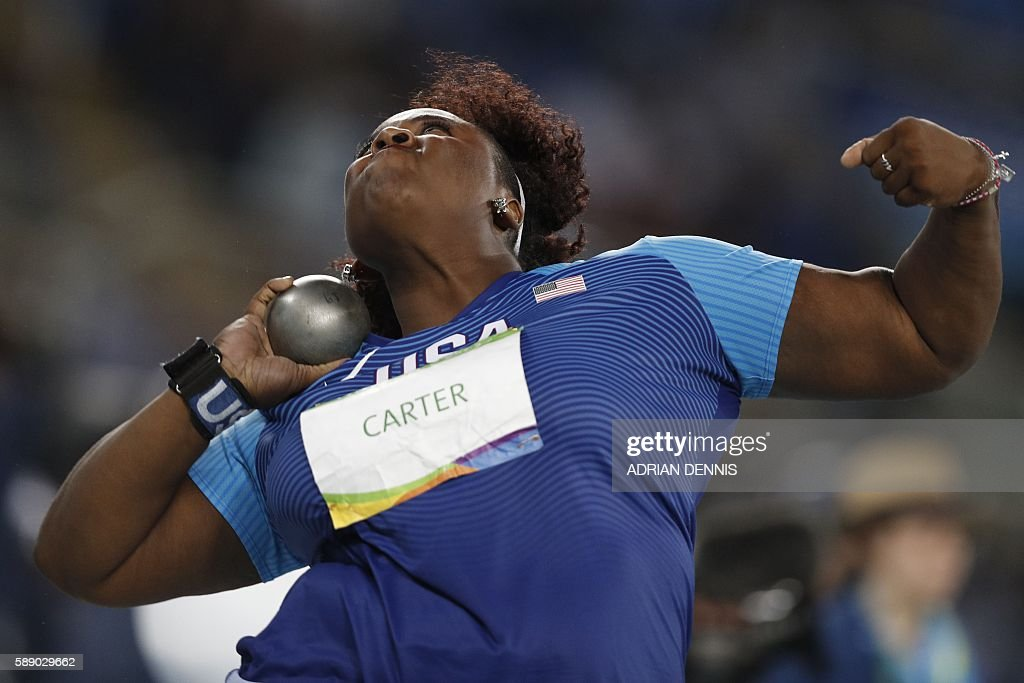 Gold medallist USA's Michelle Carter competes in the Women's Shot Put Final during the athletics event at the Rio 2016 Olympic Games at the Olympic Stadium in Rio de Janeiro on August 12, 2016. / AFP / Adrian DENNIS