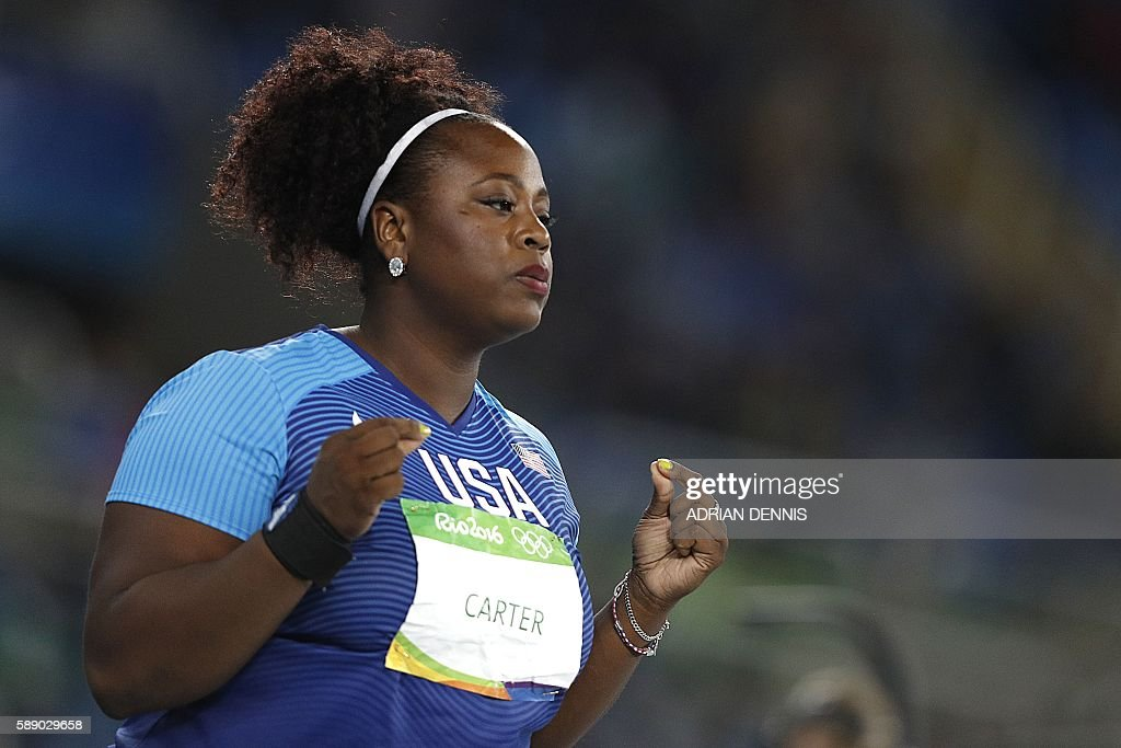 Gold medallist USA's Michelle Carter gestures in the Women's Shot Put Final during the athletics event at the Rio 2016 Olympic Games at the Olympic Stadium in Rio de Janeiro on August 12, 2016. / AFP / Adrian DENNIS