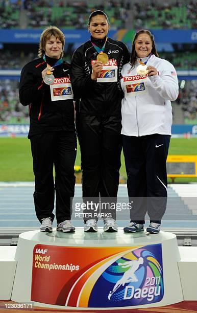 Gold medallist Valerie Adams of New Zealand poses with silver medallist Nadzeya Ostapchuk of Belarus and bronze medallist Jillian Camarena-Williams...
