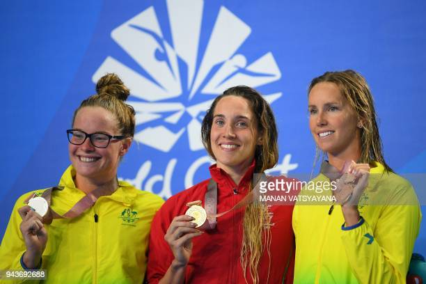 Gold medallist Wales' Alys Thomas poses with silver medallist Australia's Laura Taylor and bronze medallist Australia's Emma McKeon after the...