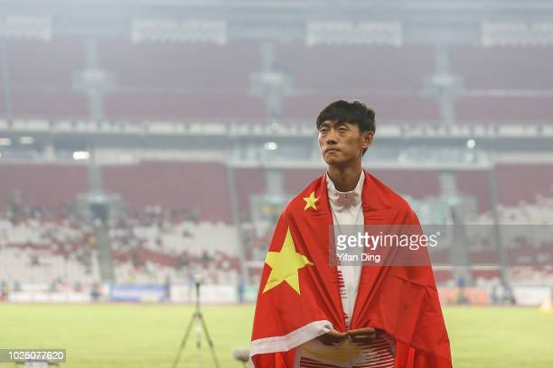 Gold medallist Wang Kaihua of China during Athletics MenÕs 20km Race Walk medal ceremony at GBK Main Stadium on day eleven of the Asian Games on...
