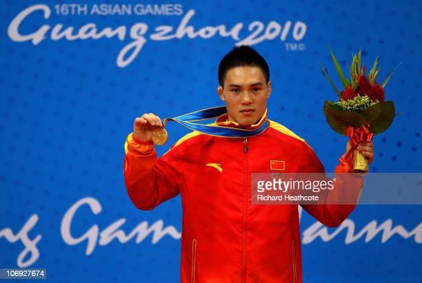 Gold medallist Xinjie Li of China in the 56kg Men�s Sanshou Wushu during day five of the 16th Asian Games Guangzhou 2010 at Nansha Gymnasium on...