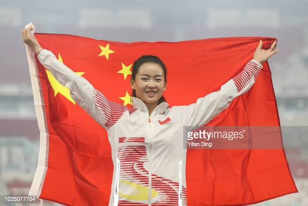 Gold medallist Yang Jiayu of China pose for photo during Athletics WomenÕs 20km Race Walk medal ceremony at GBK Main Stadium on day eleven of the...