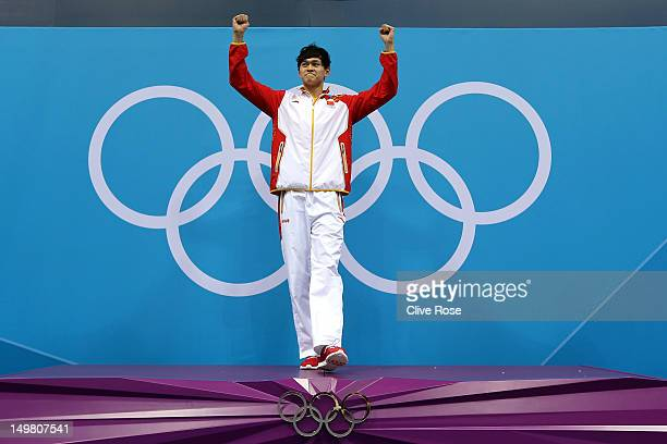Gold medallist Yang Sun of China celebrates on the podium during the medal ceremony for the Men's 1500m Freestyle Final on Day 8 of the London 2012...