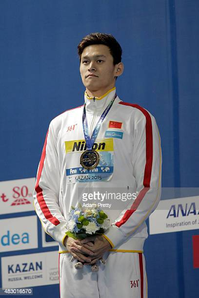 Gold medallist Yang Sun of China poses during the medal ceremony for the Men's 800m Freestyle Final on day twelve of the 16th FINA World...