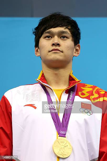Gold medallist Yang Sun of China poses on the podium during the medal ceremony for the Men's 1500m Freestyle Final on Day 8 of the London 2012...