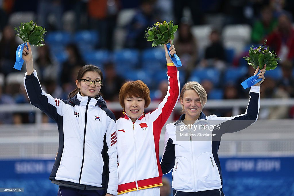 Gold medallist Yang Zhou (C) of China stands on the podium during the flower ceremony with silver medallist Suk Hee Shim (L) of South Korea and bronze medallist Arianna Fontana of Italy after the Ladies' 1500 m Final Short Track Speed Skating on day 8 of the Sochi 2014 Winter Olympics at the Iceberg Skating Palace on February 15, 2014 in Sochi, Russia.