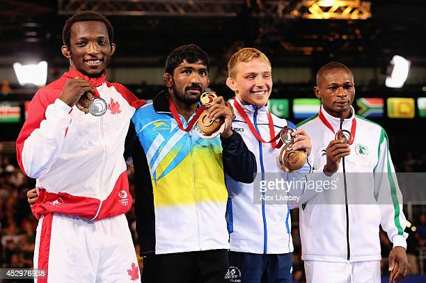 Gold medallist Yogeshwar Dutt of India poses with silver medallist Jevon Balfour of Canada and bronze medallists Alex Gladkov of Scotland and Sampson...