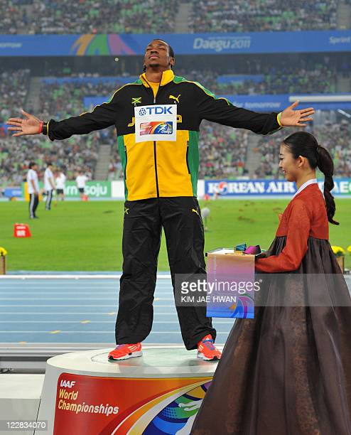 Gold medallist Yohan Blake of Jamaica gestures during the award ceremony for the men's 100 metres final at the International Association of Athletics...