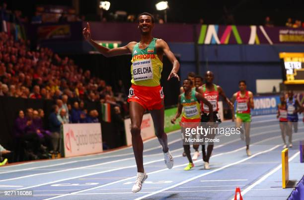 Gold Medallist Yomif Kejelcha of Ethopia celebrates winning the Men's 3000 Metres Final during the IAAF World Indoor Championships on Day Four at...