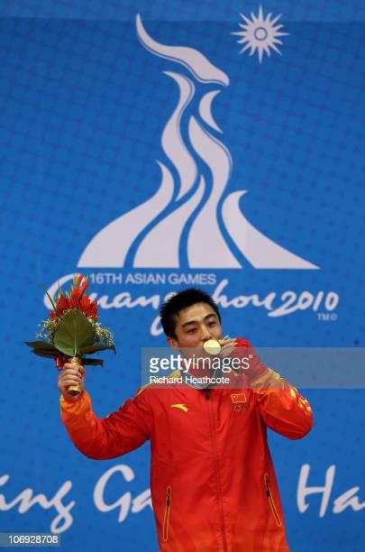 Gold medallist Yong Zhang of China in the Men's 70kg Sanshou Wushu during day five of the 16th Asian Games Guangzhou 2010 at Nansha Gymnasium on...