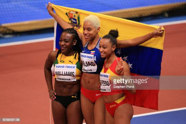 Gold Medallist Yulimar Rojas of Venezuela Silver Medallist Kimberly Williams of Jamaica and Bronze Medallist Ana Peleteiro of Spain celebrate after...