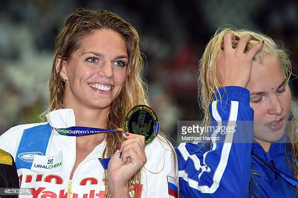 Gold medallist Yuliya Efimova of Russia poses with silver medallist Ruta Meilutyte of Lithuania during the medal ceremony for the Women's 100m...