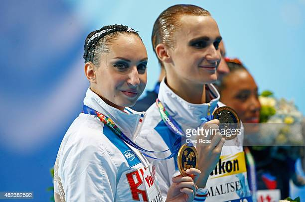 Gold medallists Aleksandr Maltsev and Darina Valitova of Russia celebrate during the medal ceremony in the Mixed Duet Free Synchronised Swimming...