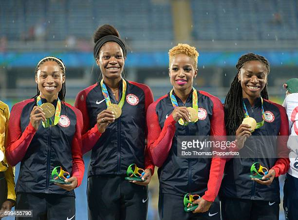 R Gold medallists Allyson Felix Phyllis Francis Natasha Hastings and Courtney Okolo of the United States during the medal ceremony for the Women's...