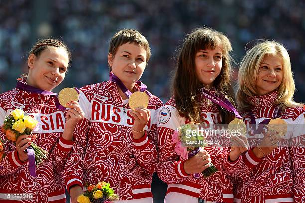 Gold medallists Anastasiya Ovsyannikova Svetlana Sergeeva Elena Ivanova and Margarita Goncharova of Russia pose on the podium during the medal...