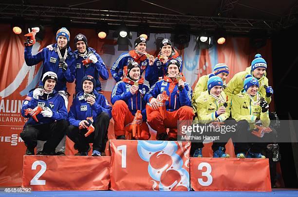 Gold medallists Anders Bardal Anders Jacobsen Anders Fannemel and Rune Velta of Norway pose with silver medallists Stefan Kraft Michael Hayboeck...