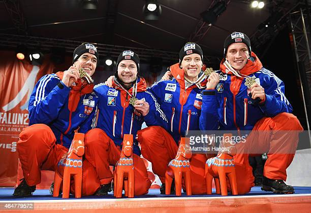 Gold medallists Anders Bardal Anders Jacobsen Rune Velta and Anders Fannemel of Norway pose during the medal ceremony for the Men's Team HS134 Large...