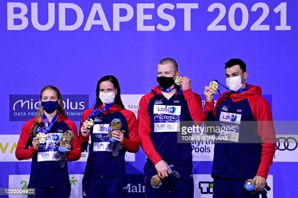Gold medallists Anna Hopkin, Kathleen Dawson, Adam Peaty and James Guy of Great Britain pose on the podium after the Mixed 4x100m Medley Relay...