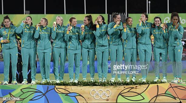 Gold medallists Australia celebrate on the podium during the womens rugby sevens medal ceremony during the Rio 2016 Olympic Games at Deodoro Stadium...