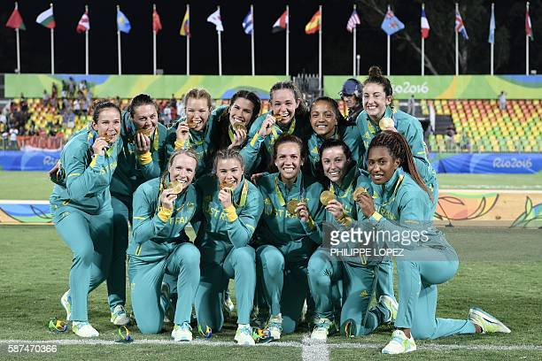 Gold medallists Australia celebrate winning the womens rugby sevens tournament during the Rio 2016 Olympic Games at Deodoro Stadium in Rio de Janeiro...