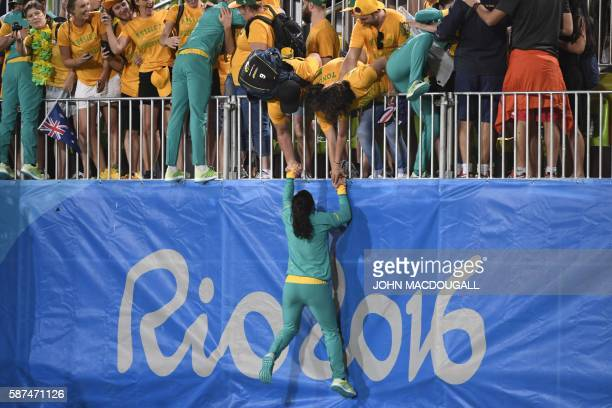 Gold medallists Australia celebrate with their supporters after the womens rugby sevens medal ceremony during the Rio 2016 Olympic Games at Deodoro...
